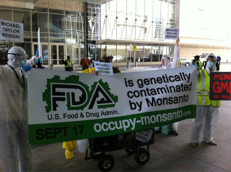 GCU Food Safety Summit1 Photos of the Genetic Crimes Unit Protesting Michael Taylor at the 2012 Food Safety Summit Washington Convention Center Washington resign Protest Photos Michael Taylor Food Safety Summit Food Safety Czar FDA DC