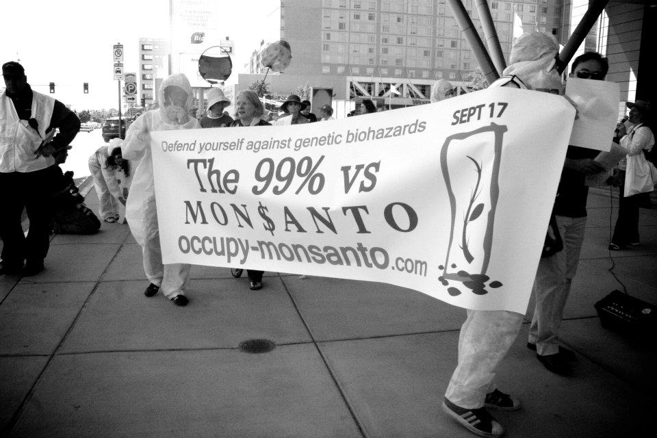 occupy monsanto bio convetion1 Photos from the Sidewalk Session outside of the BIO International Conference signs RoundUp Protest Photos Lucky Charms Kashi GMO Labeling gmo Genetic Crime Scene Fruity Pebbles Frosted Flakes Demonstration biohazmat Biohazard BIO International Conference