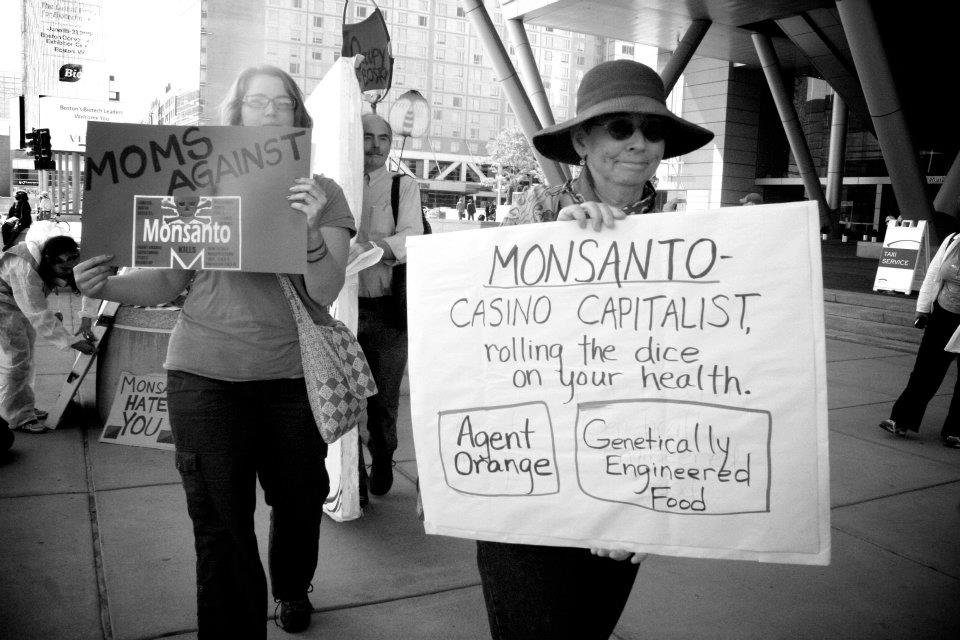 occupy monsanto bio convetion6 Photos from the Sidewalk Session outside of the BIO International Conference signs RoundUp Protest Photos Lucky Charms Kashi GMO Labeling gmo Genetic Crime Scene Fruity Pebbles Frosted Flakes Demonstration biohazmat Biohazard BIO International Conference