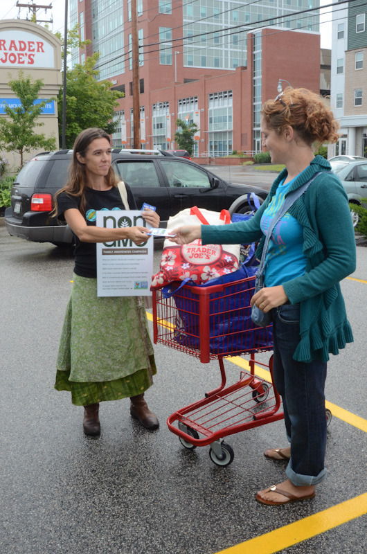 ecowomb shopping for truth at trader joes4 Photos of Shopping for Truth at Trader Joes in Portland, Maine USDA Organic Traitor GMOs Trader Joes Trader GMOs Shopping for Truth Protest Proof Portland Parking Lot Non GMO Project Non GMO Maine Kids incident report GMO Labeling gmo Family Eco Womb Demonstration Conscious Caravan