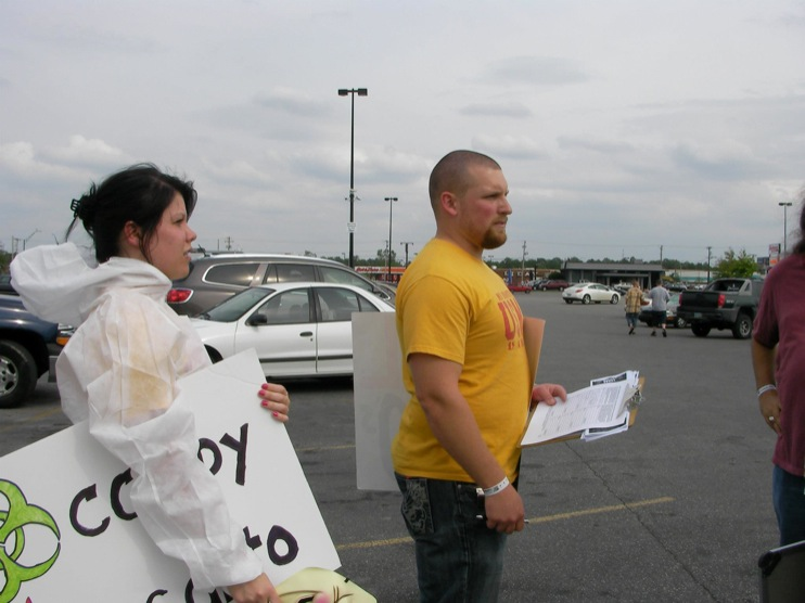 occupy monsanto defiance10 INCIDENT REPORT: Photos from GCU Field Agents outside Walmart in Defiance, Ohio Walmart Protest Parking Lot Ohio OH manager GMO Labeling GMO Corn gmo Demonstration Defiance Decontamination Event