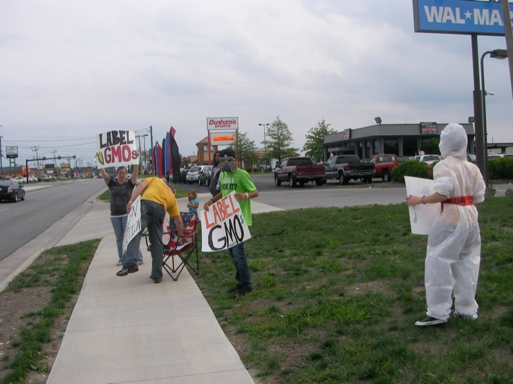 occupy monsanto defiance11 INCIDENT REPORT: Photos from GCU Field Agents outside Walmart in Defiance, Ohio Walmart Protest Parking Lot Ohio OH manager GMO Labeling GMO Corn gmo Demonstration Defiance Decontamination Event
