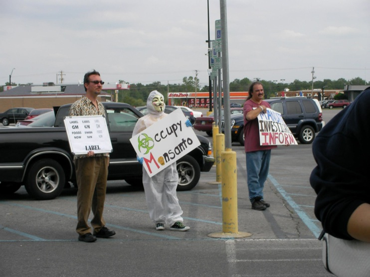 occupy monsanto defiance13 INCIDENT REPORT: Photos from GCU Field Agents outside Walmart in Defiance, Ohio Walmart Protest Parking Lot Ohio OH manager GMO Labeling GMO Corn gmo Demonstration Defiance Decontamination Event