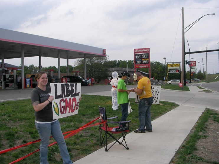 occupy monsanto defiance14 INCIDENT REPORT: Photos from GCU Field Agents outside Walmart in Defiance, Ohio Walmart Protest Parking Lot Ohio OH manager GMO Labeling GMO Corn gmo Demonstration Defiance Decontamination Event