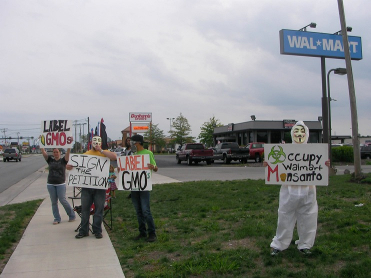 occupy monsanto defiance16 INCIDENT REPORT: Photos from GCU Field Agents outside Walmart in Defiance, Ohio Walmart Protest Parking Lot Ohio OH manager GMO Labeling GMO Corn gmo Demonstration Defiance Decontamination Event