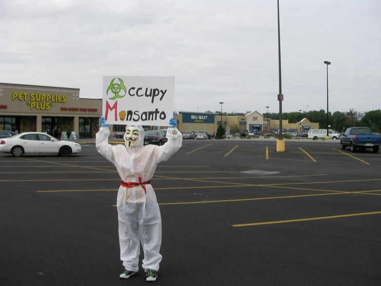 occupy monsanto defiance18 INCIDENT REPORT: Photos from GCU Field Agents outside Walmart in Defiance, Ohio Walmart Protest Parking Lot Ohio OH manager GMO Labeling GMO Corn gmo Demonstration Defiance Decontamination Event