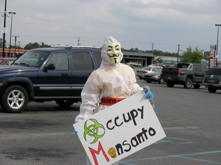 occupy monsanto defiance24 INCIDENT REPORT: Photos from GCU Field Agents outside Walmart in Defiance, Ohio Walmart Protest Parking Lot Ohio OH manager GMO Labeling GMO Corn gmo Demonstration Defiance Decontamination Event