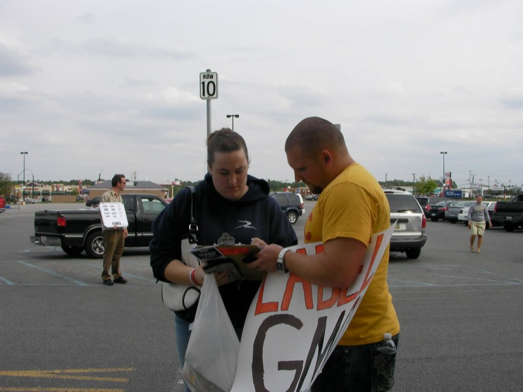 occupy monsanto defiance25 INCIDENT REPORT: Photos from GCU Field Agents outside Walmart in Defiance, Ohio Walmart Protest Parking Lot Ohio OH manager GMO Labeling GMO Corn gmo Demonstration Defiance Decontamination Event