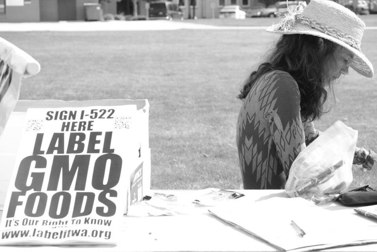 occupy monsanto olympia27 INCIDENT REPORT: Photos from GCU Field Agents at Lake Olympia, Washington Washington WA signs Protest Olympia Lake Olympia GMO Summit Demonstration