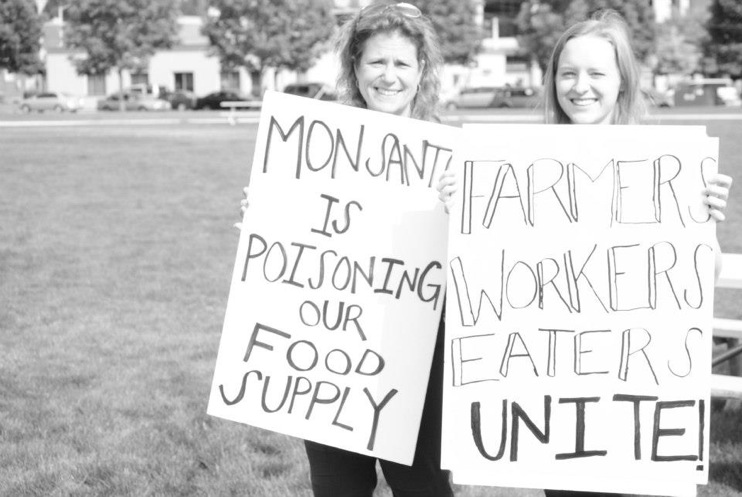 occupy monsanto olympia3 INCIDENT REPORT: Photos from GCU Field Agents at Lake Olympia, Washington Washington WA signs Protest Olympia Lake Olympia GMO Summit Demonstration