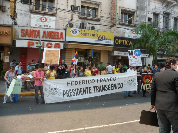 occupy monsanto paraguay1 INCIDENT REPORT: Photos & Videos from GCU Field Agents in Asuncion, Paraguay protestas Protest polica Paraguay Pantheon of the Heroes marcha Manifestacin Federico Franco Demonstration cotton Corn Asuncion 