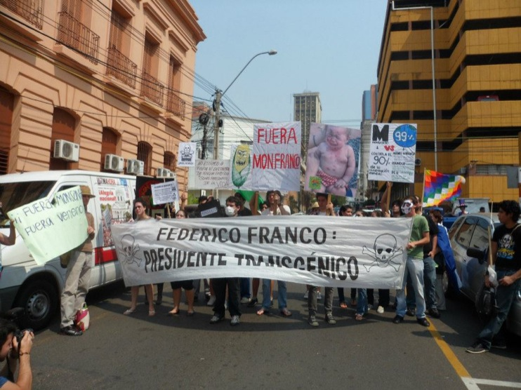 occupy monsanto paraguay2 INCIDENT REPORT: Photos & Videos from GCU Field Agents in Asuncion, Paraguay protestas Protest policía Paraguay Pantheon of the Heroes marcha Manifestación Federico Franco Demonstration cotton Corn Asuncion