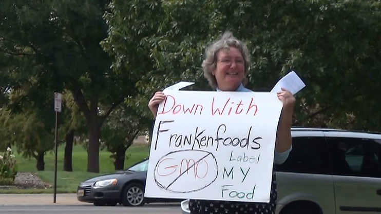 occupy monsanto topeka4 INCIDENT REPORT: Photos from GCU Field Agents outside of the State Capitol in Topeka, Kansas Topeka State Capitol Protest Midwest KS Kansas Frankenfoods Demonstration capital bees