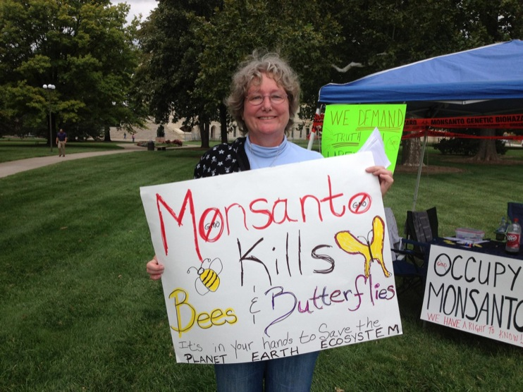 occupy monsanto topeka5 INCIDENT REPORT: Photos from GCU Field Agents outside of the State Capitol in Topeka, Kansas Topeka State Capitol Protest Midwest KS Kansas Frankenfoods Demonstration capital bees