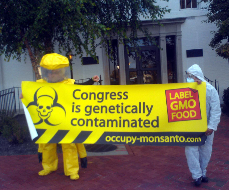 congress is genetically contaminated INCIDENT REPORT: Photos from outside of the Republican Party Headquarters in Washington, DC Washington USDA Republican Party Protest Police Occupy the GMO Candidate Michael Taylor GMO Labeling GCU Field Agents FDA Demonstration DC Corn Chimp Congress Capitol Hill