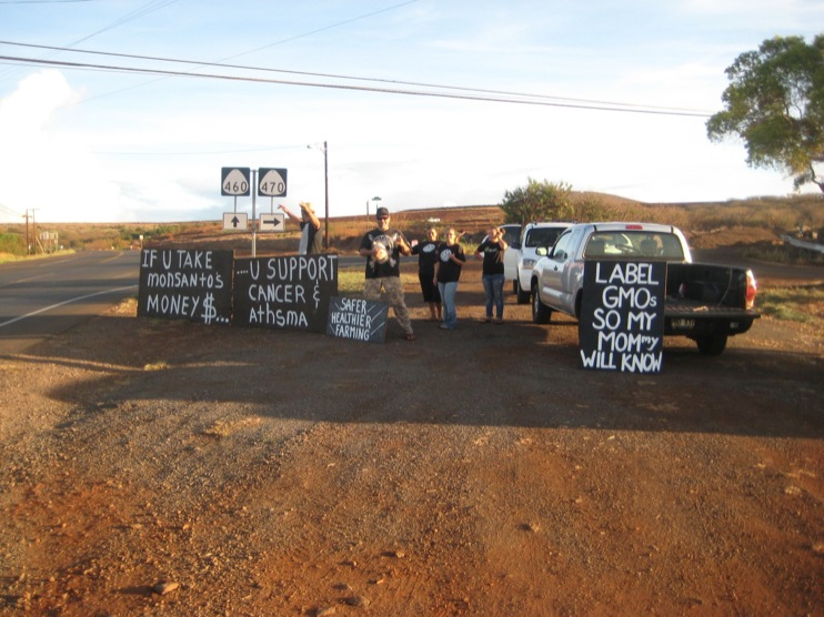 occupy monsanto molokai1 INCIDENT REPORT: Photos from GCU Field Agents in Molokai, Hawaii signs Protest pesticides organic Molokai Kids Island HI Hawaii GMO Free Molokai Farms Demonstration Chemicals