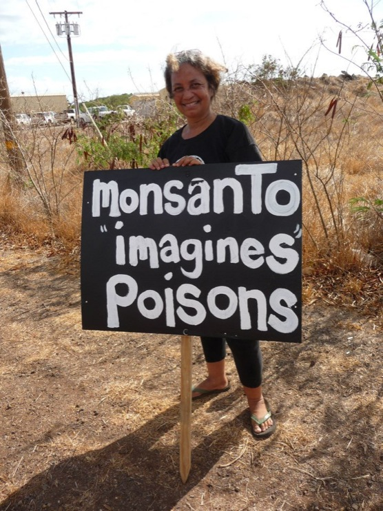 occupy monsanto molokai10 INCIDENT REPORT: Photos from GCU Field Agents in Molokai, Hawaii signs Protest pesticides organic Molokai Kids Island HI Hawaii GMO Free Molokai Farms Demonstration Chemicals
