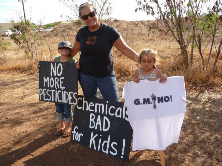 occupy monsanto molokai13 INCIDENT REPORT: Photos from GCU Field Agents in Molokai, Hawaii signs Protest pesticides organic Molokai Kids Island HI Hawaii GMO Free Molokai Farms Demonstration Chemicals
