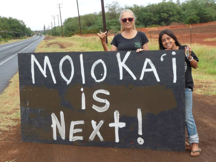 occupy monsanto molokai7 INCIDENT REPORT: Photos from GCU Field Agents in Molokai, Hawaii signs Protest pesticides organic Molokai Kids Island HI Hawaii GMO Free Molokai Farms Demonstration Chemicals