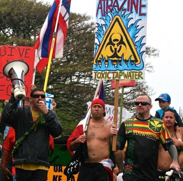 march in march to evict monsanto 3 9 2013 kauai2 INCIDENT REPORT: Thousands March in March to Evict Monsanto from Kauai Walter Ritte Testing Protest Poipu Photos pesticides March in March to Evict Monsanto Kauai GMO Labeling gmo Demonstration Chemicals agriculture